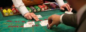 Player plays against the house in black Jack